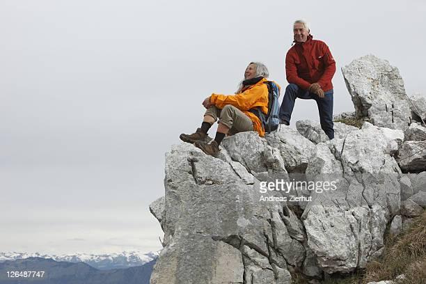Senior couple on mountain peak, Italy