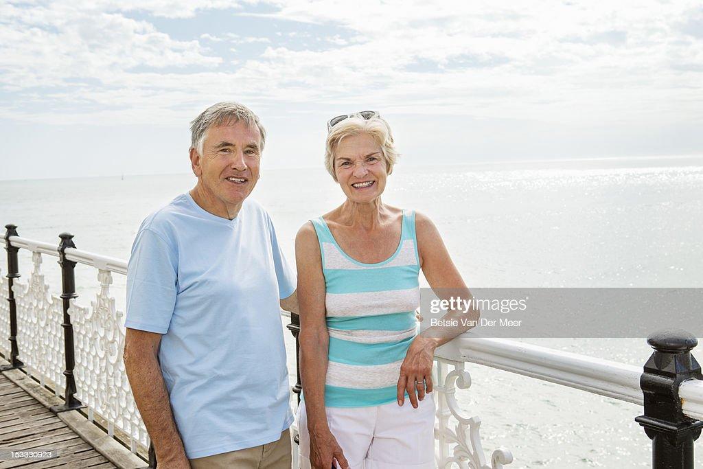 Senior couple on pier overlooking the sea. : Stock-Foto
