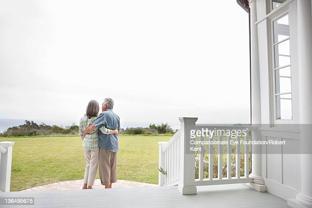Senior couple on porch, rear view