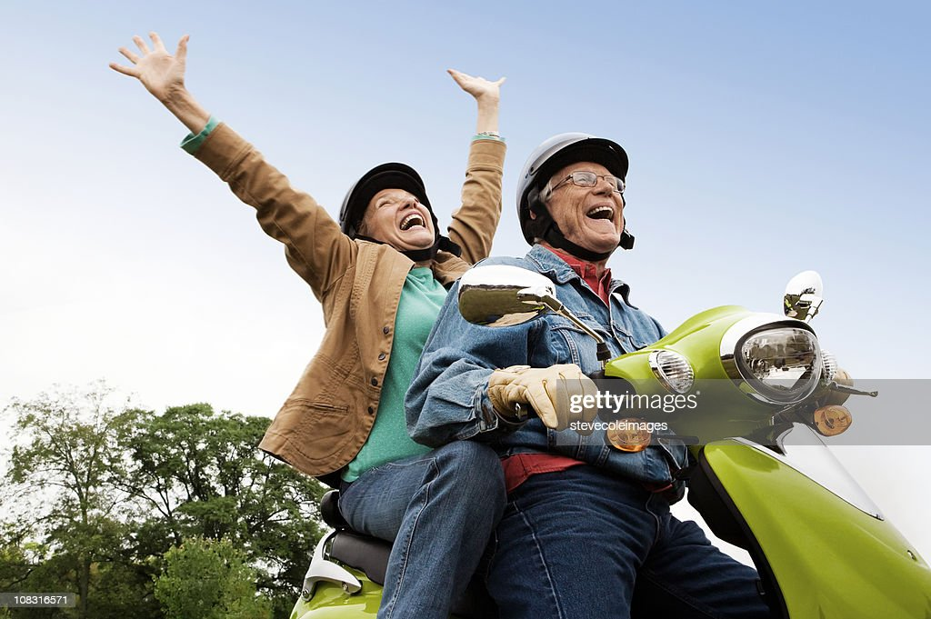 Senior Couple on Scooter : Stock Photo