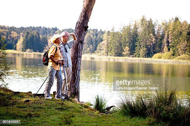 Senior couple on the lakeside, looking at view, Osterseen, Germany