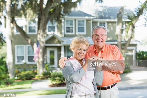 Senior couple outside home