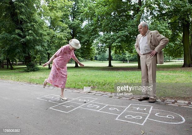 Senior couple play hopscotch
