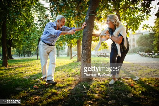 Senior couple playing a game of Tag. : Stock Photo