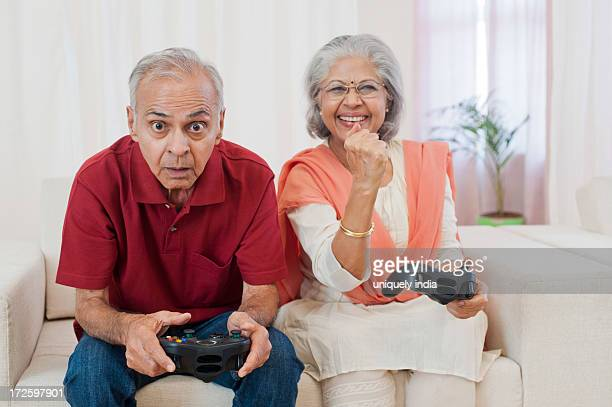 Senior couple playing a video game