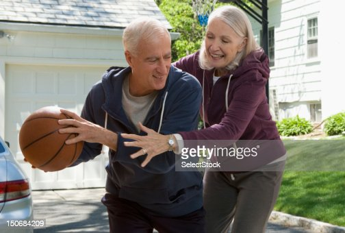 Senior couple playing basketball
