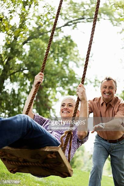 Senior Couple Playing on a Park Swing