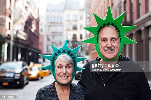 senior couple portrait with liberty hats