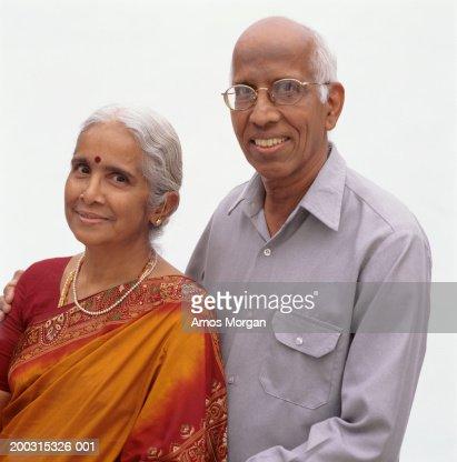 Senior couple posing in studio, woman in sari, portrait : Stock Photo