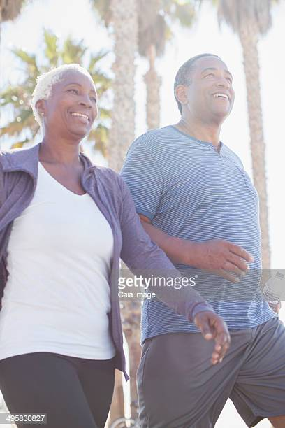 Senior couple power walking outdoors