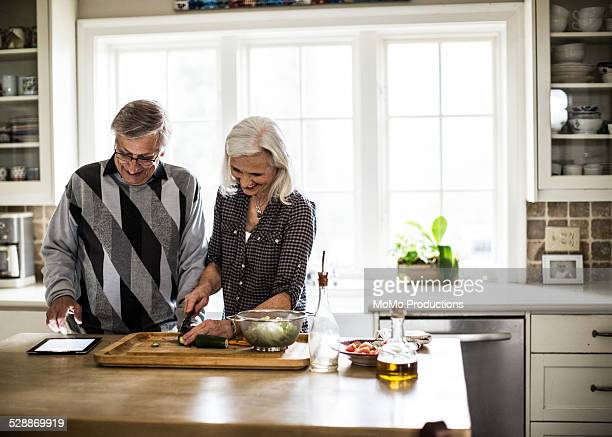 Senior couple preparing dinner