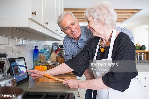 Senior couple preparing food at home