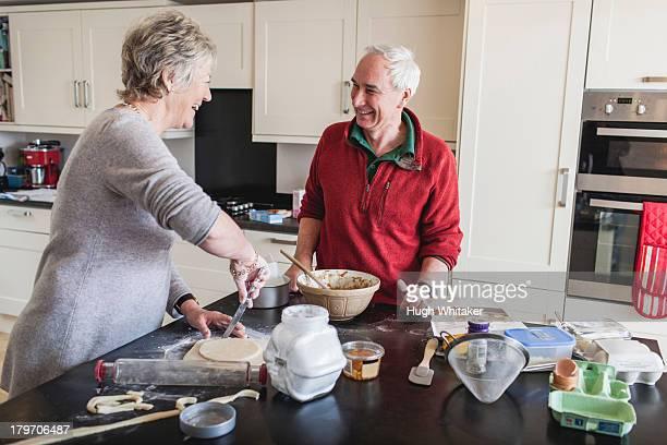 Senior couple preparing pastry
