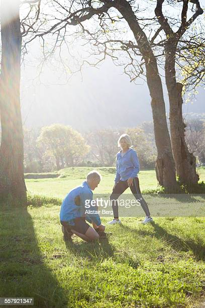 Senior couple preparing to go jogging