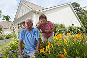 Senior couple preparing to plant flowers in garden