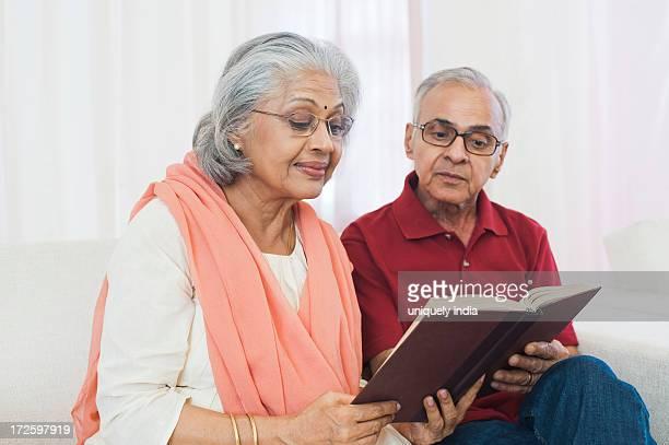 Senior couple reading a book
