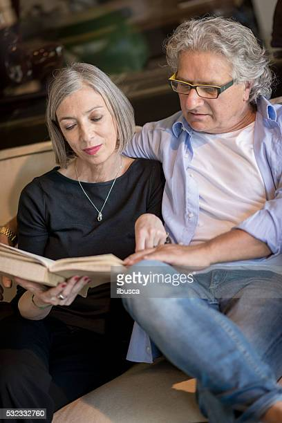 Senior couple reading a book together