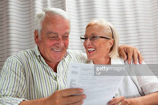Senior Couple reading documents