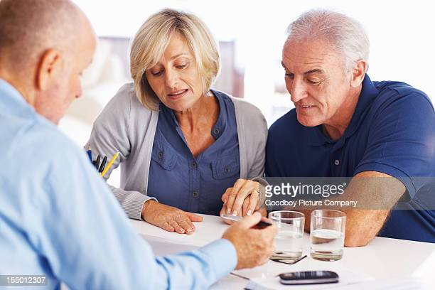 Senior couple reading investment plans