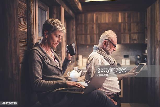 Senior couple reading on digital device