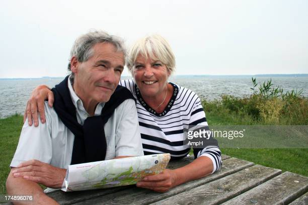 Senior couple reads a map