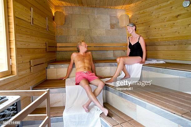 Senior couple relaxing in textile sauna
