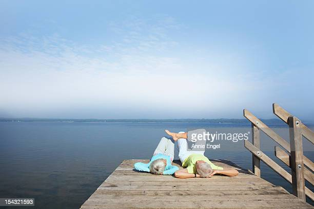 Senior couple relaxing on jetty
