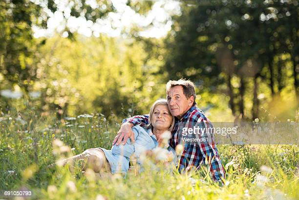 Senior couple relaxing together on a meadow