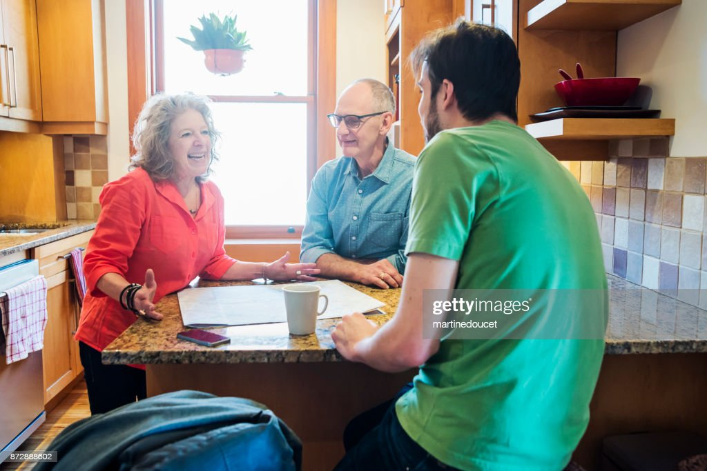 Senior couple renting a room to a latin-american student. : Stock Photo