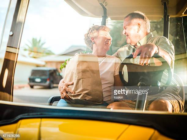 Senior couple returning home after shopping