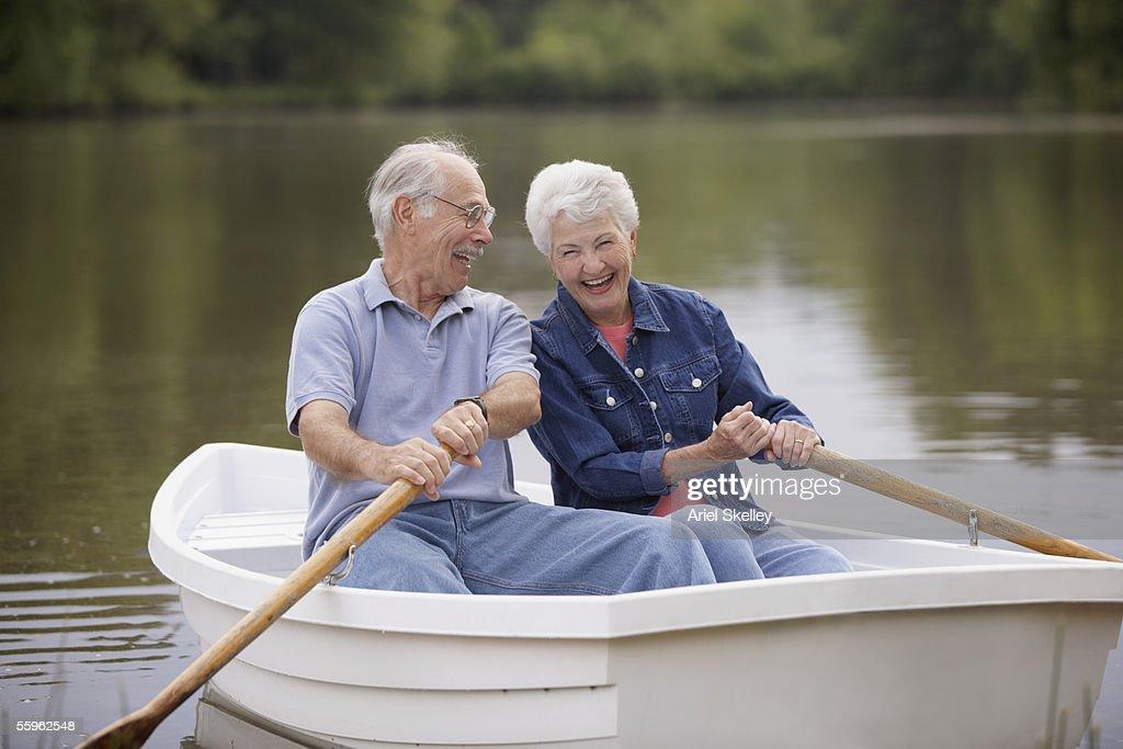 Senior couple rowing boat : Stock Photo