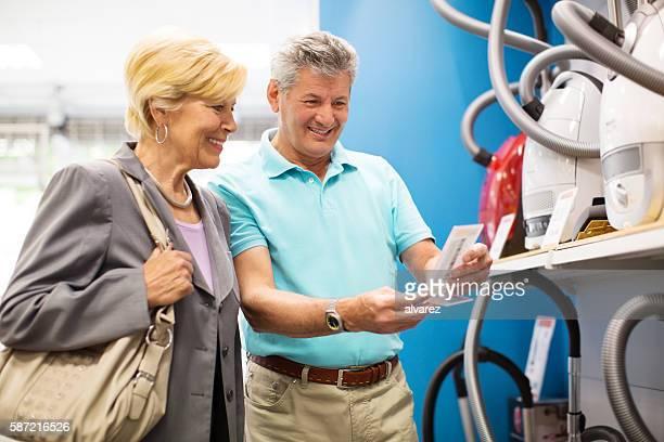 Senior couple shopping for home appliances
