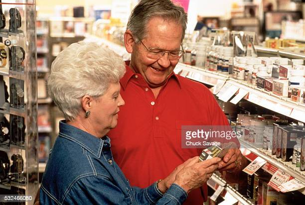 Senior couple shopping for vitamins