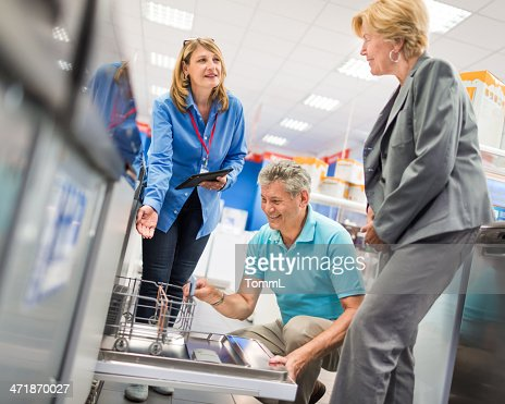 Senior Couple Shopping In Appliance Store