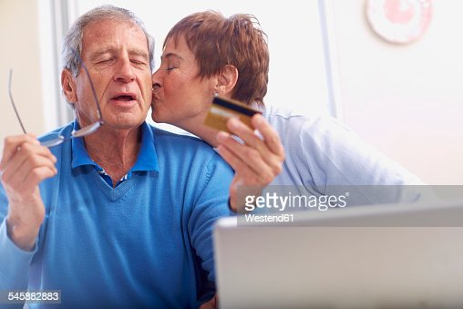 Senior couple shopping online at home