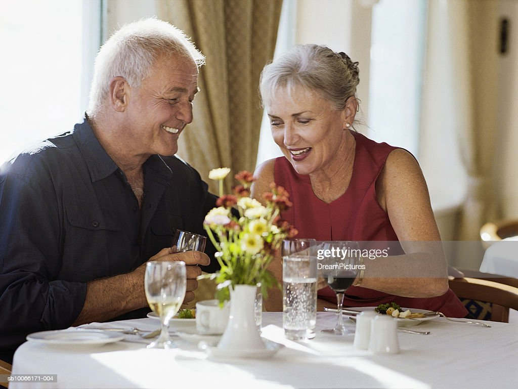 Senior couple sitting at table in restaurant : Stock Photo