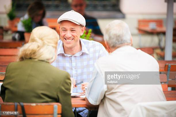 senior couple sitting in a cafe