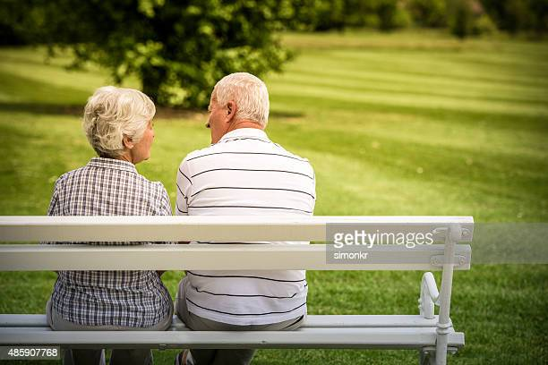 Senior couple sitting in park