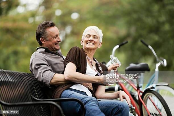 Senior Couple Sitting on a Park Bench