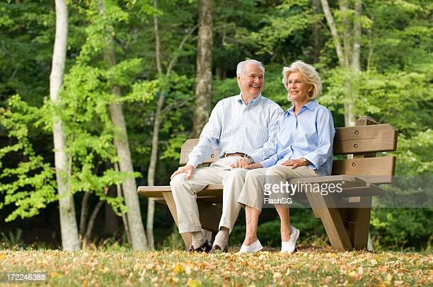 Senior Couple Sitting On A Park Bench