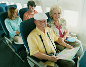 Senior Couple Sitting on a Plane