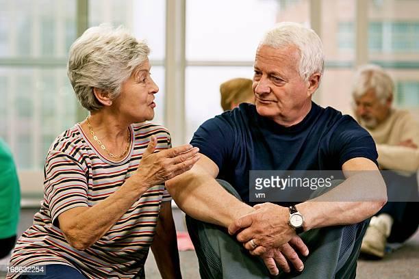 Senior couple sitting on floor