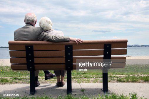 Senior Couple Sitting On The Park Bench