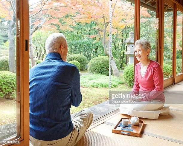 Senior Couple Sitting On Veranda