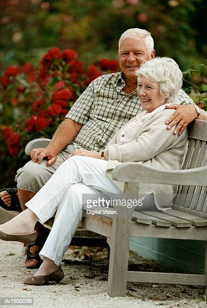 A Senior Couple Sittng on a Park Bench
