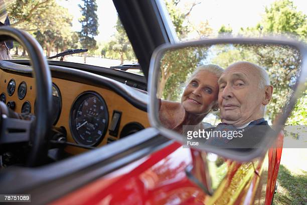 Senior Couple Smiling in Mirror