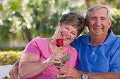 Senior couple smiling romantically