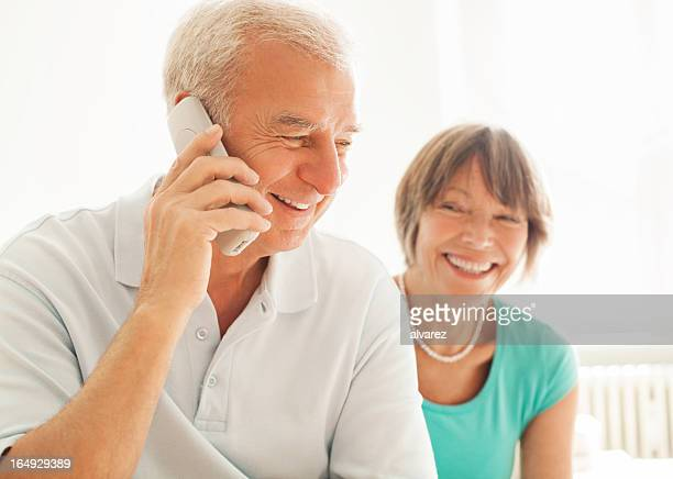 Senior couple speaking on the phone