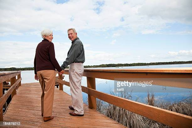 Senior couple standing by water