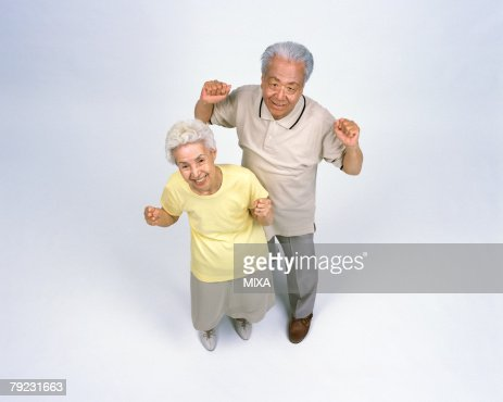 A senior couple standing : Stock Photo